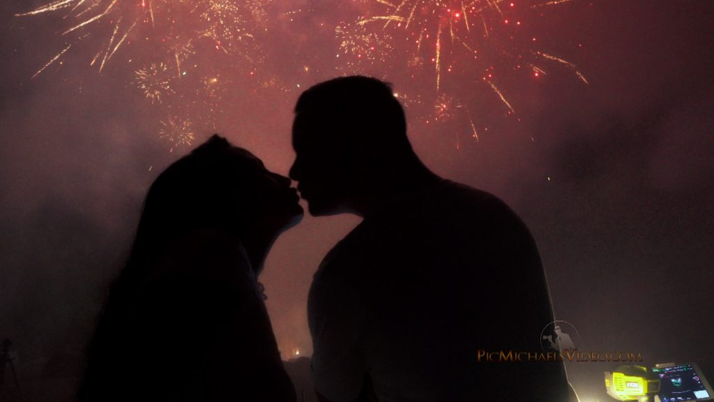 Couple Kissing with Fireworks in sky